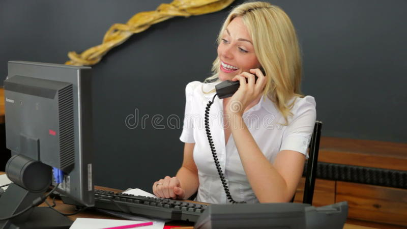 Hotel receptionist using computer and phone stock footage video hotel receptionist using computer and phone stock footage video 38355738 sciox Images