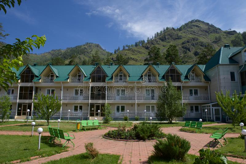 Hotel, recreation center, three-story building. With a large number of rooms for guests. Siberia, Altai Mountains, Russia royalty free stock photo