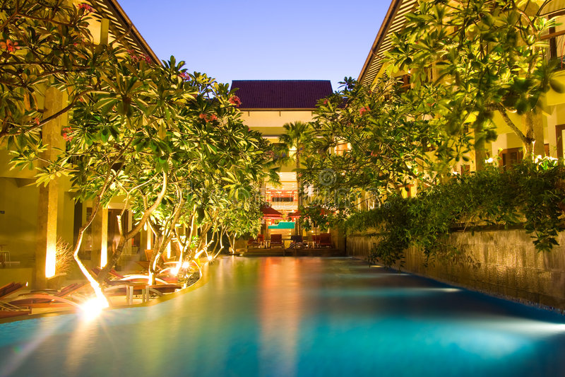 Hotel resort. With pool in the middle under magnolia trees stock image