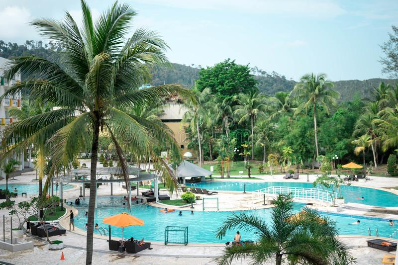 Hotel resort and swimming pool area in waterfront Batam, Indonesia, May 4, 2019. Hotel resort and swimming pool area in waterfront Batam, Indonesia, May 4 2019 royalty free stock images