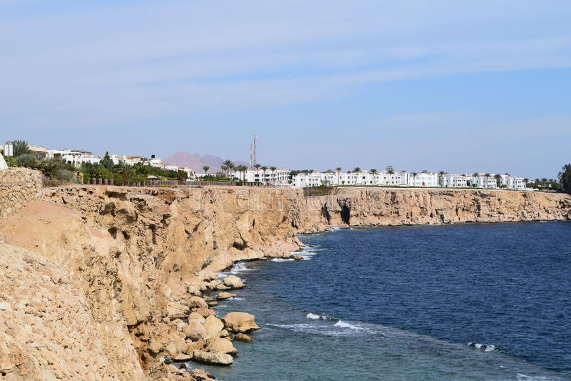 Hotel on the rocky shore stock photos