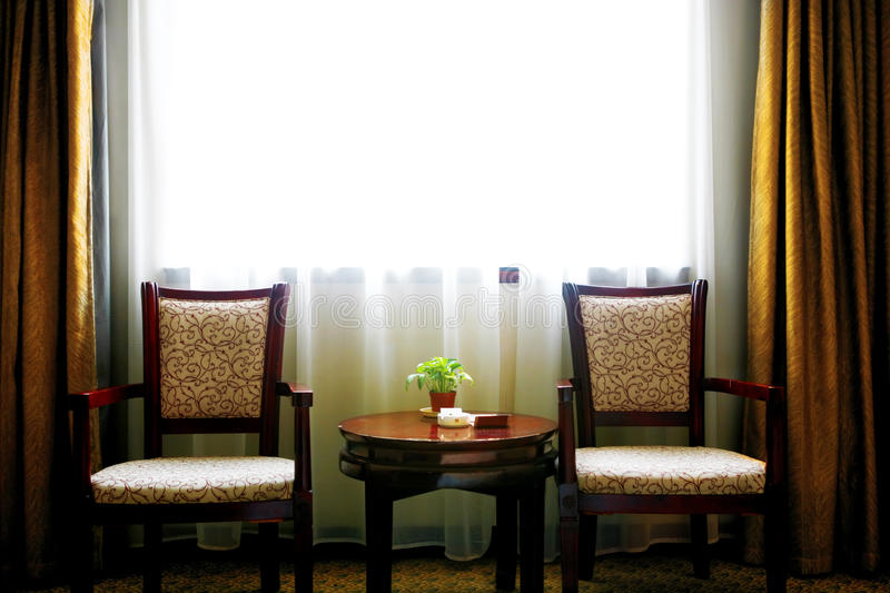 Hotel room. Two chairs and a table in the hotel living room stock image