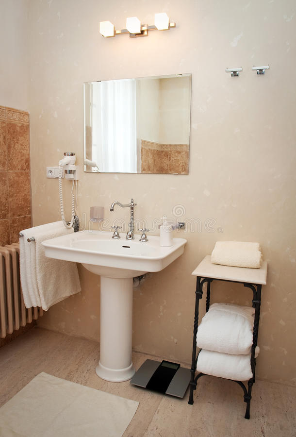 Hotel room bathroom. Interior details of a modern hotel bathroom royalty free stock photo