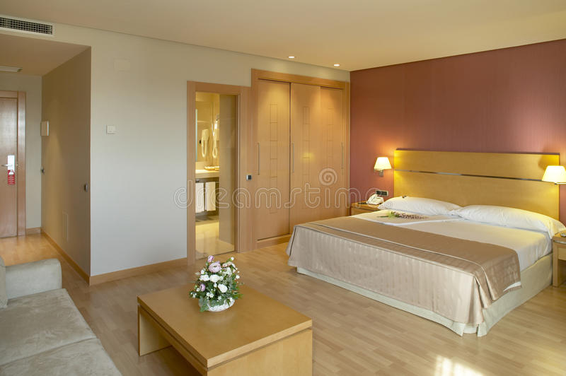 Hotel room with bed and bathroom. Horizontal format stock photos