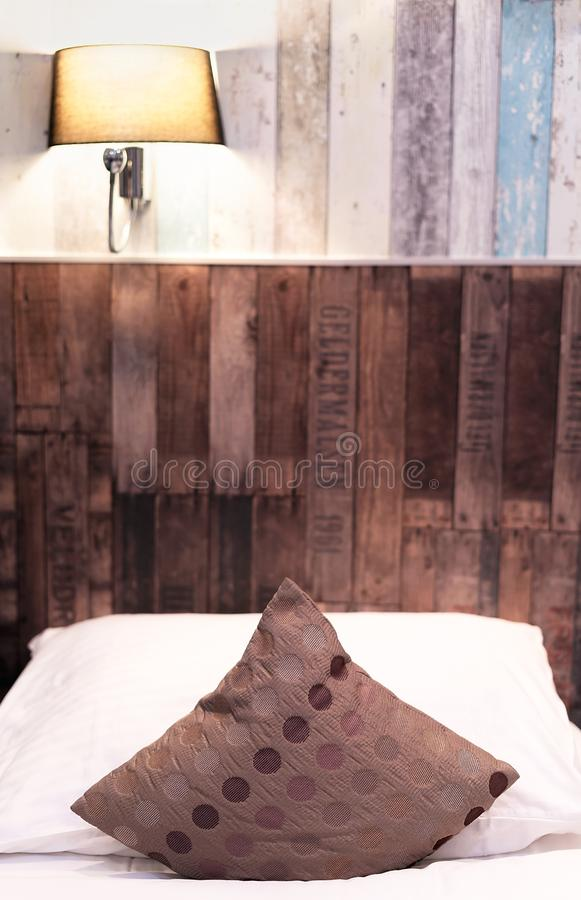 Hotel room with a bed at night. Lights turned on. Hotel room with a bed along a striped wooden wall at night. Lights turned on royalty free stock images