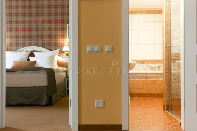 Hotel room - look to bedroom and bathroom. Hotel room - look to bedroom and bathroom stock images