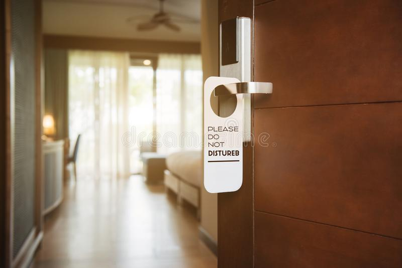 Hotel room with please do not disturb sign stock images