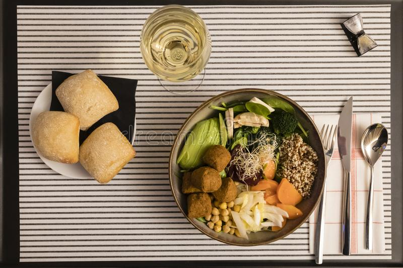 Hotel Room service: vegan meal and white wine.  royalty free stock images