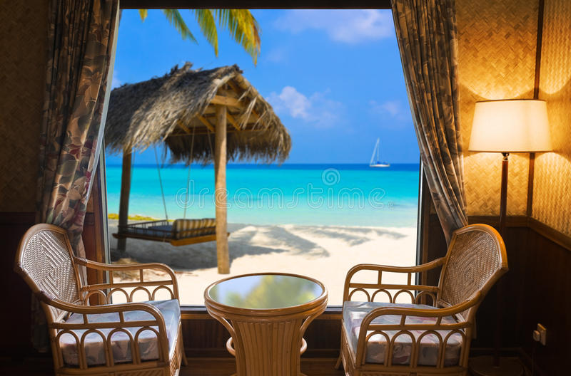 Hotel room and tropical landscape stock photography