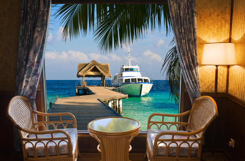 Hotel room and tropical landscape stock photos