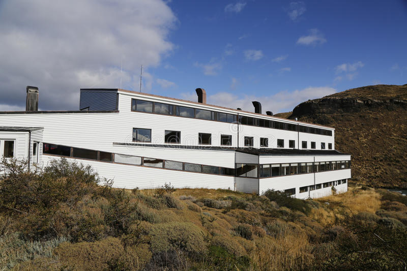 Hotel Salto Chico Explora Patagonia at turquoise Lake Pehoe in Torres del Paine National Park. TORRES DEL PAINE, CHILE - APRIL 4, 2015: Hotel Salto Chico Explora stock photography