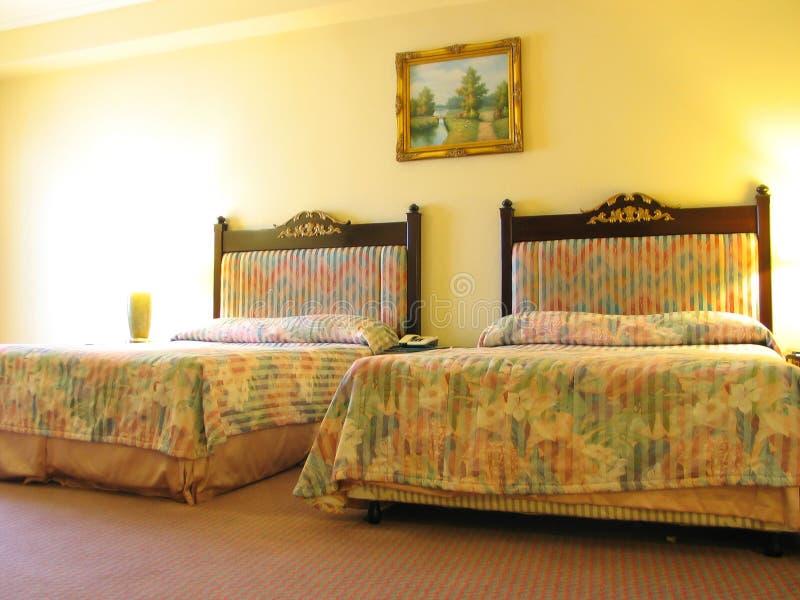 Hotel-Schlafzimmer lizenzfreie stockbilder