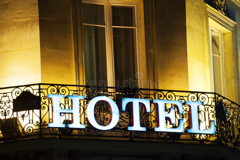 Hotel sign. Illuminated hotel sign in Paris, at the dusk