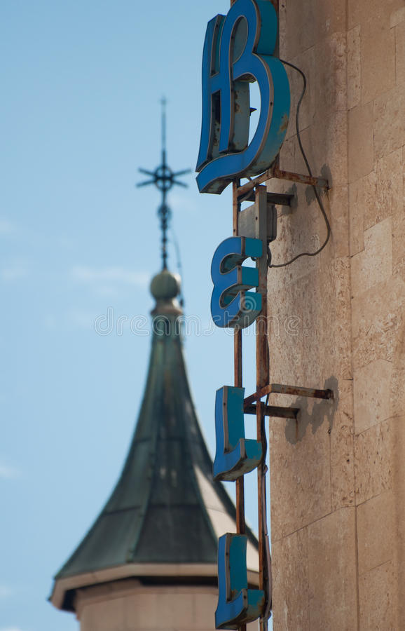 Hotel sign and church tower stock image