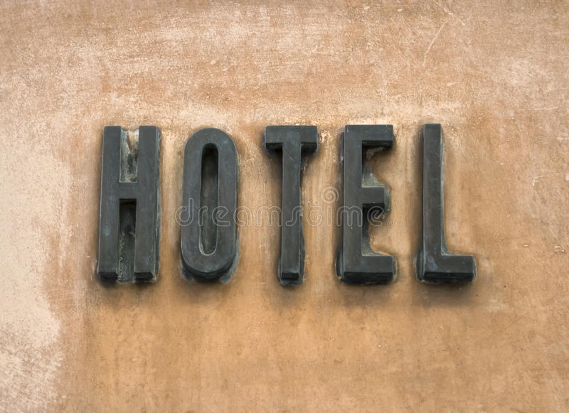 Hotel Sign On Wall Background. Vacation Concept royalty free stock photos