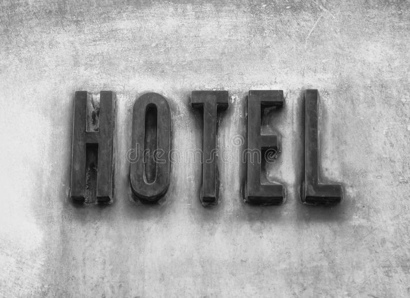 Hotel Sign On Wall Background. Vacation Concept, black and white royalty free stock photo