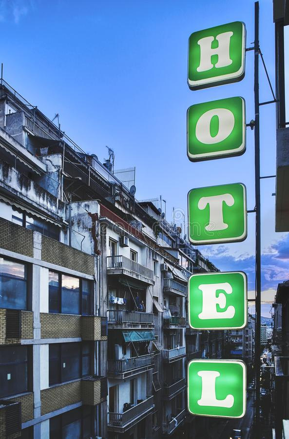 Hotel signboard in a street of Athens at nightfall. Greece. stock photography