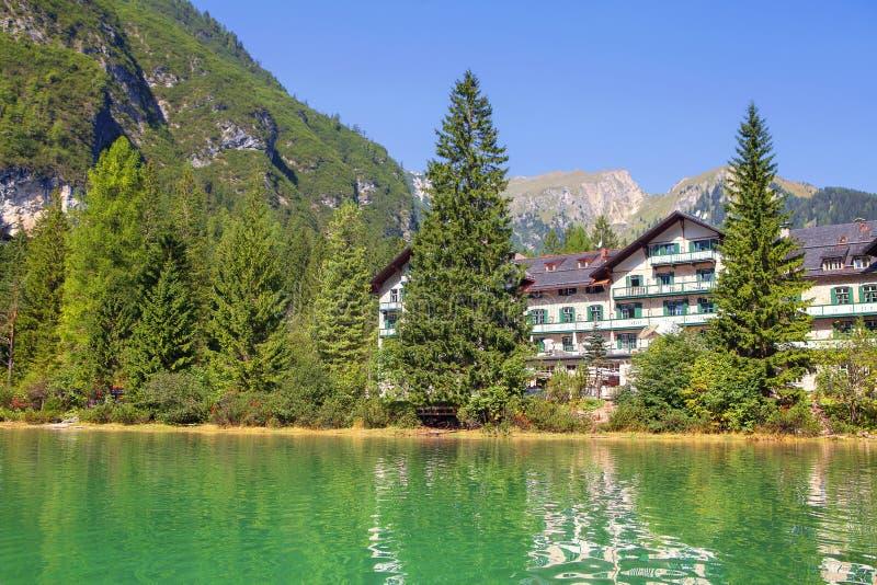 hotel near lake and mountain stock photography