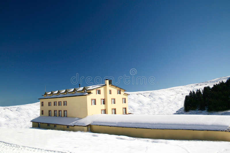 Hotel on a snowy mountain stock photo