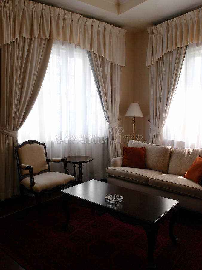 Hotel suite sitting room space. A photograph showing the living room or sitting room area in the small suite of an upscale luxury hotel, with comfortable sofa stock photography