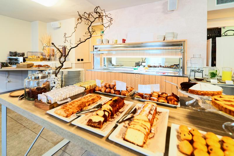 Hotel sweet cakes pastry breakfast restaurant interior background stock photo