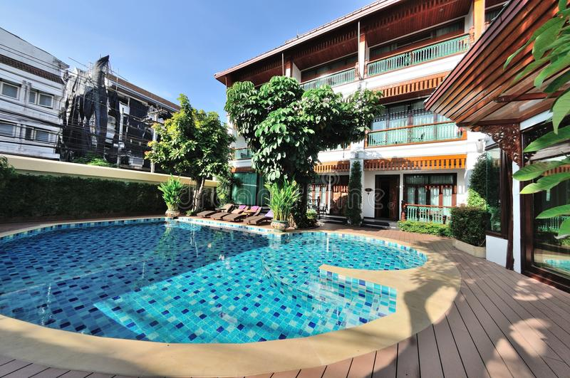 Hotel Swimming pool. With restaurant and room stock images