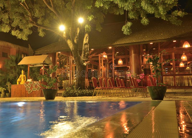 Hotel swimming pool side restaurant. Hotel swimming pool with restaurant stock image