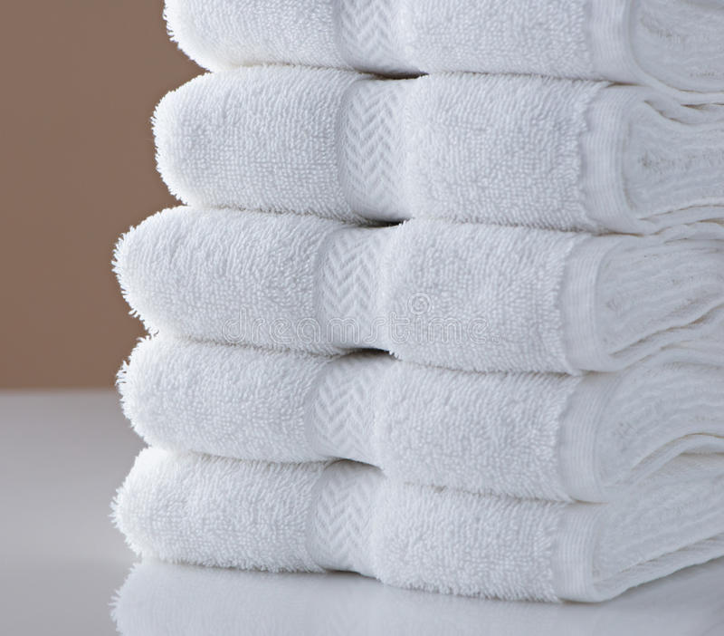 Hotel Towels. A stack of clean, white hotel towels stock image