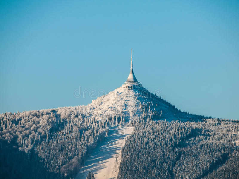 Hotel and transmitter Jested with ski slope stock photography