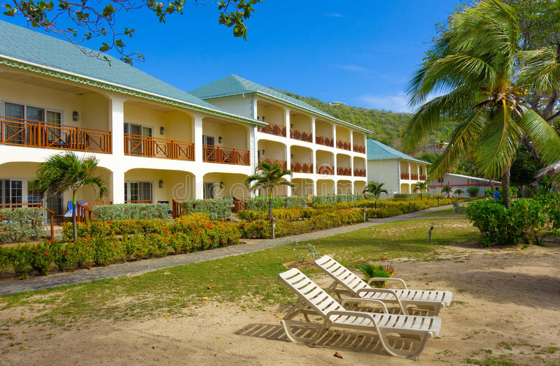 Hotel units at friendship beach, bequia. Charming waterfront accommodations in the windward islands royalty free stock photo