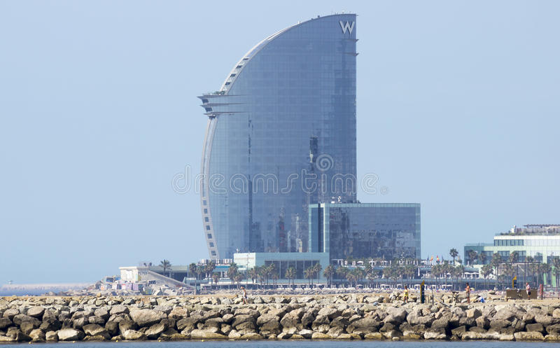 Hotel Vela. BARCELONA, SPAIN - JULY 12, 2015: W Barcelona Hotel, known as the Hotel Vela (Sail Hotel), designed by Architect Ricardo Bofill. Located on the new royalty free stock photography