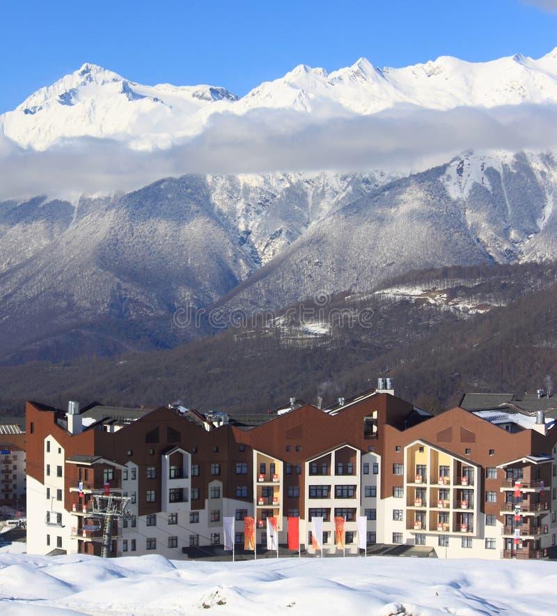 Hotel village at the ski resort, snowy Caucasian Mountains. Krasnaya Polyana, Russia, Russia - February 2, 2016: hotel village at the ski resort, snowy Caucasian stock photos