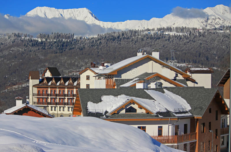 Hotel village at the ski resort, snowy Caucasian Mountains. Russia stock photography