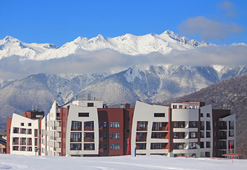Hotel village at the ski resort, snowy Caucasian Mountains. Russia stock photos