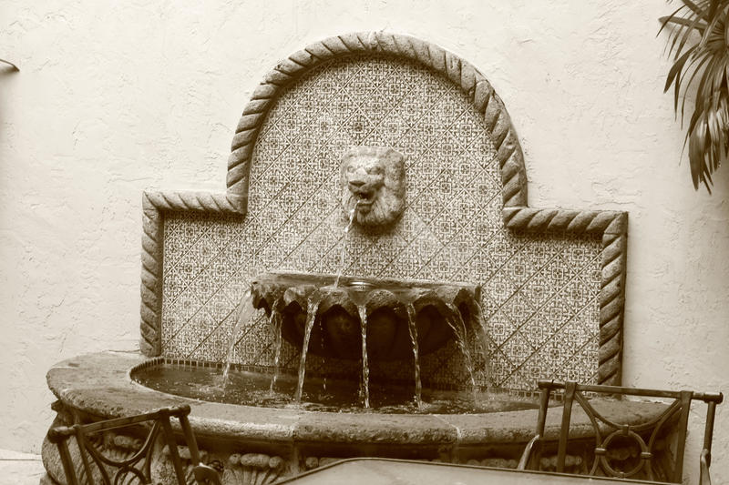 Hotel waterfountain. Courtyard water feature in the mediterranean style of spanish revival. photo shot in sepia mode. boca raton golf resort and spa in south stock image