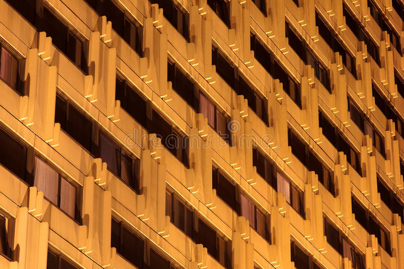 Hotel windows at night stock photography