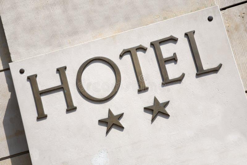Hotelltecken för två stjärna arkivbilder