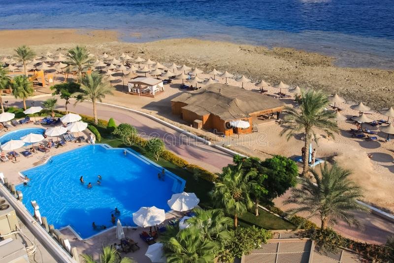 Hotels and beach infrastructure in the tourist part of Sharm El Sheikh. Egyptian resort. Sharm El Sheikh, Egypt - June 23, 2013: Hotels and beach infrastructure stock photography