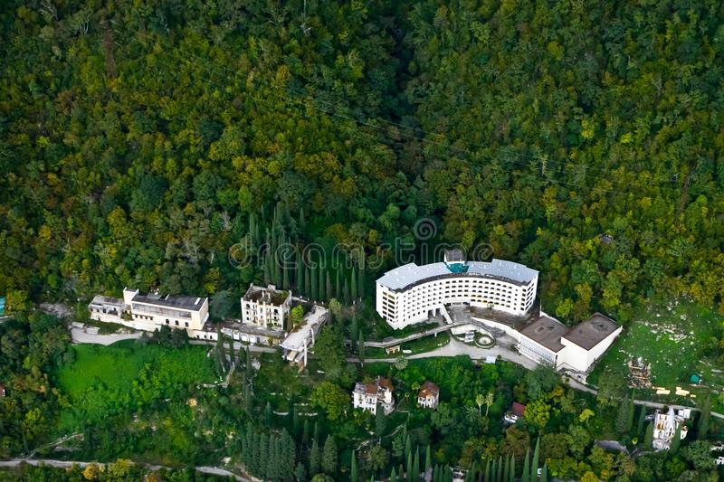 Hotels among the green forest, aerial photograph. Green trees. Abkhazia, Gagra stock photography