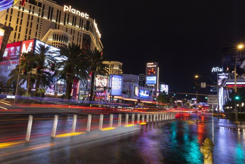 Hotels reflecting in flood water in Las Vegas, NV on July 19, 2013. LAS VEGAS - JULY 19, 2013 - Vegas Strip on July 19, 2013 in Las Vegas. Vegas hotels and cars stock images