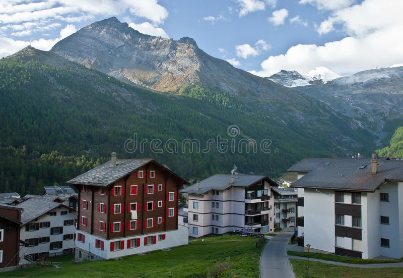 Hotels in saas fee. Saas fee hotels with mountains in background on sunrise, swiss royalty free stock image