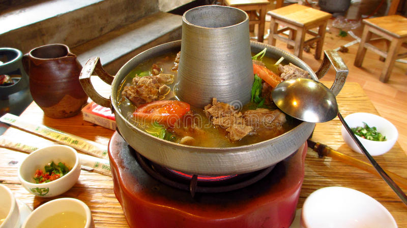 Hotpot with cured meat. Is a local cuisine of LiJiang, YunNan, China stock images