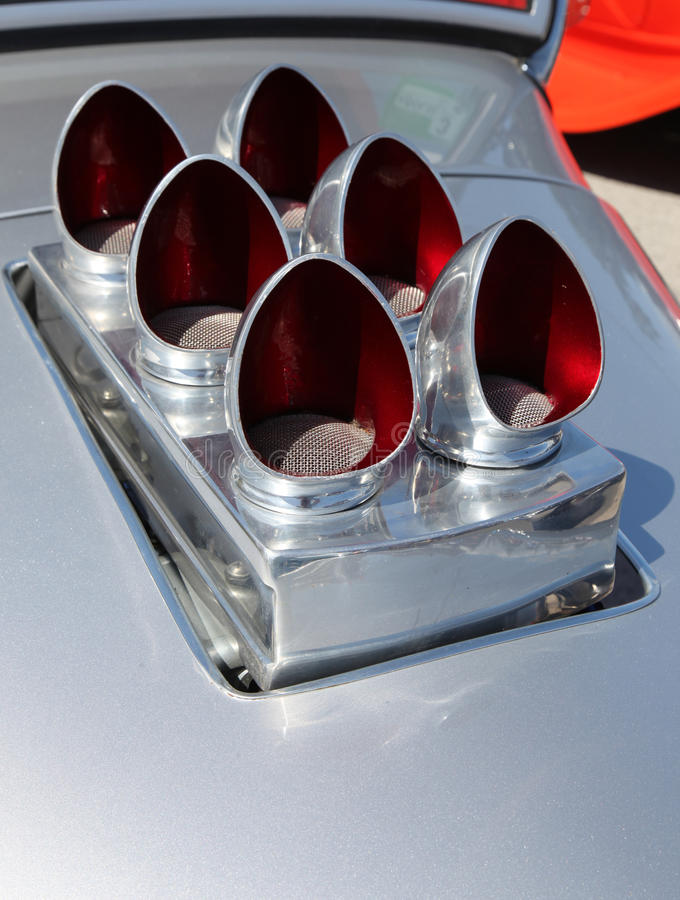 Hotrod air intake. A fancy air intake arrangement on a classic hotrod royalty free stock image