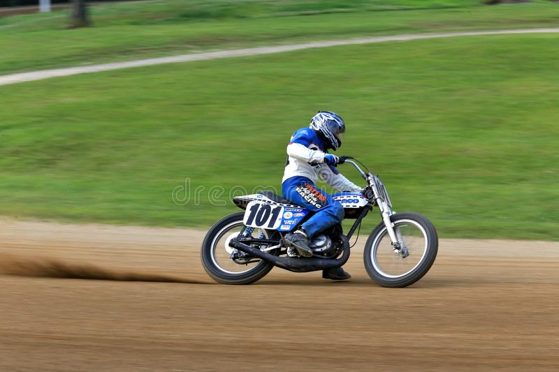 Hotshoe racing bike. Motorcycle races the flat track at the pro motorcycle racing event on the dirt oval flat track speedway, Ashland County, Ohio, USA royalty free stock photos