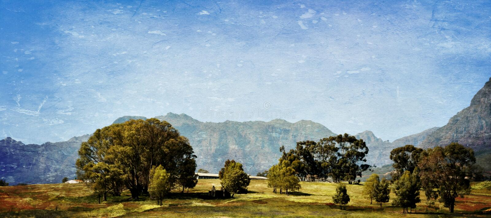 Hottentots Holland Mountains. Landscape with the Hottentots Holland Mountains and trees on a meadow stock photo