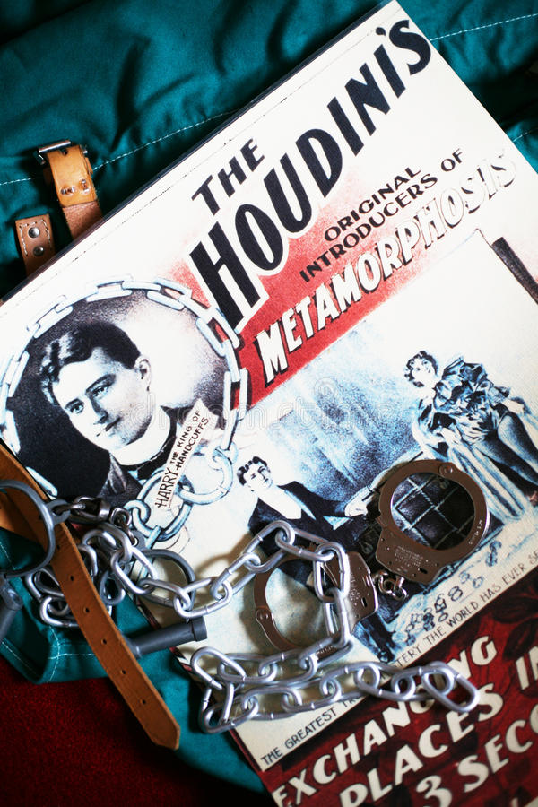 Houdini coloured poster handcuffs chain strait jacket stock images
