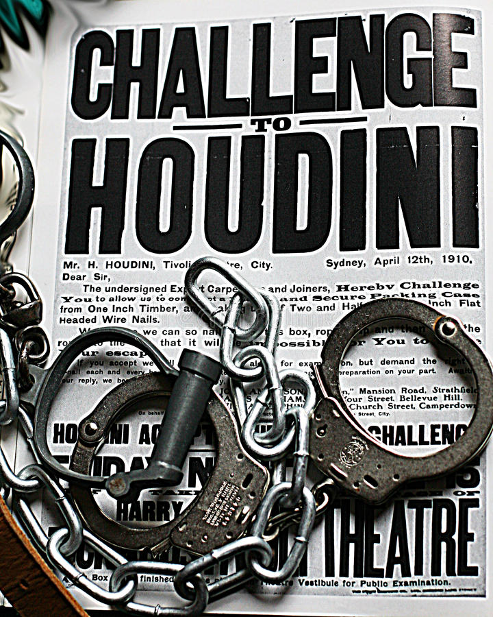 Houdini poster handcuffs and chain stock photos