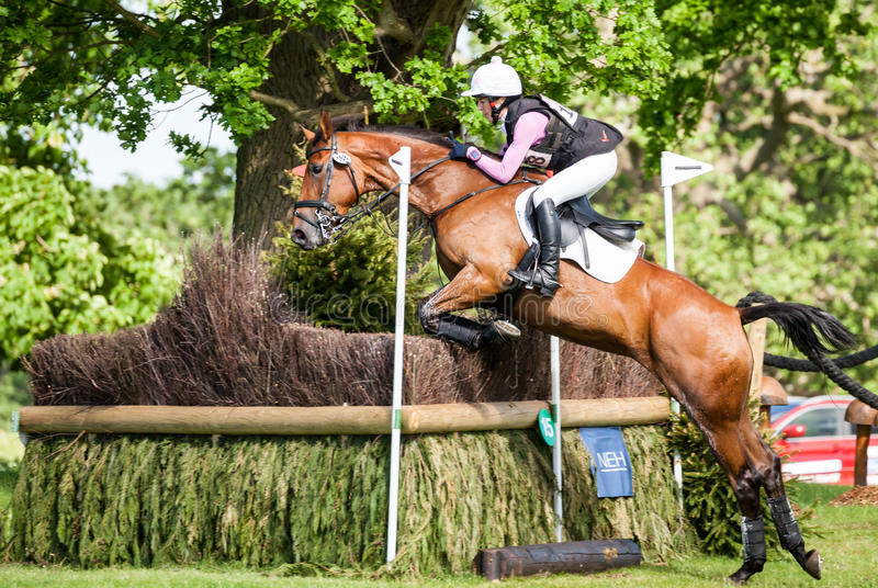 Houghton international horse trials Becky Woolven riding Dhi Babette K. HOUGHTON, NORFOLK/ENGLAND - May 25th 2017: Houghton International Horse Trials 2017 Becky royalty free stock photo