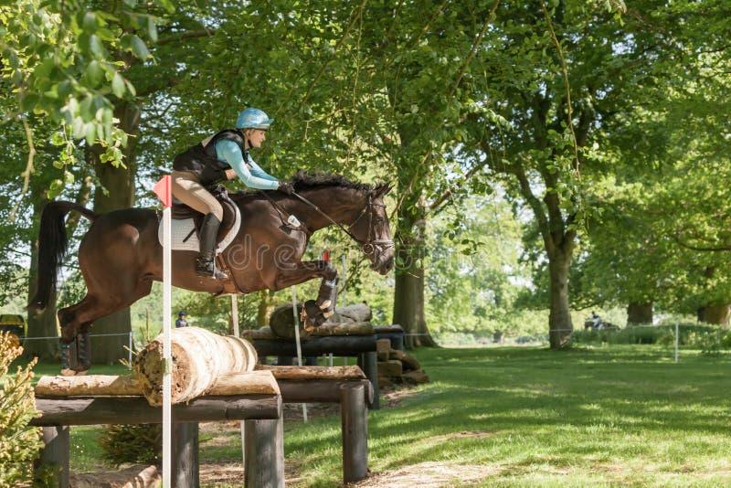 Houghton international horse trials Chloe Lynn riding Calzini. HOUGHTON, NORFOLK/ENGLAND - May 25th 2017: Houghton International Horse Trials 2017 Chloe Lynn royalty free stock photography