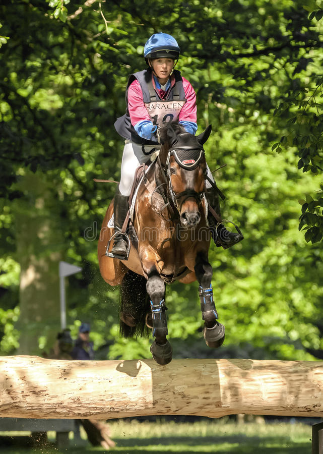 Houghton international horse trials Hannah Bate riding Call Me B. HOUGHTON, NORFOLK/ENGLAND - May 25th 2017: Houghton International Horse Trials 2017 Hannah Bate royalty free stock photos